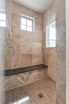 Tile shower with bench and windows