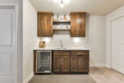 Option for a wet bar with cabinets and fridge