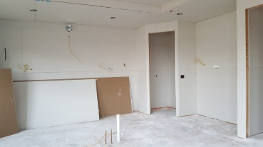 Home has been dry walled, view of the kitchen