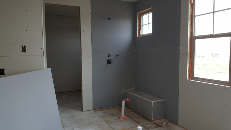 The shower has been dry walled.