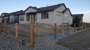 Fencing going up around this Sunrise Ridge Fort Collins Patio Home