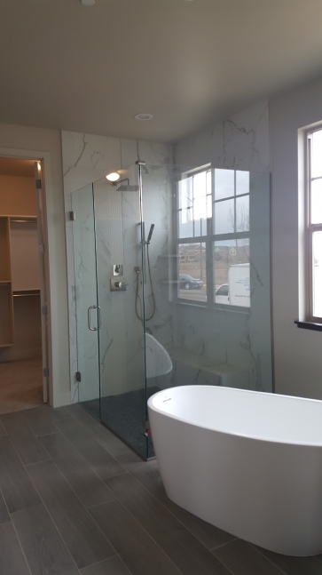 Amazing full wrap around glass shower at the patio homes at Sunrise Ridge