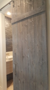 Wood Barn door for the half bath in 4014 Rock Creek