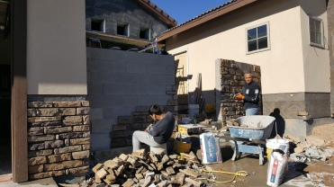 Stonework guys appreciating the nice weather