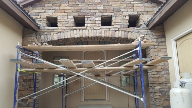 Scaffolding up for exterior rock work