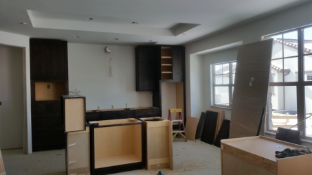 Cabinets being installed in the kitchen at this Sunrise Ridge Patio Home