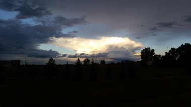 A view from behind Sunglow Court at the Sunrise Ridge Patio Homes of a passing Thunderstorm